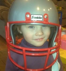 Maddie wearing Patriots helmet